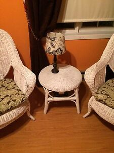 2 white wicker chairs, cushions and table