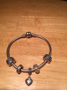Pandora Bracelet with 3 charms and 2 spacers.
