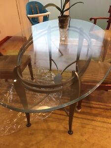 "Solid glass oval dining table wrought iron grey base 42""x72"""