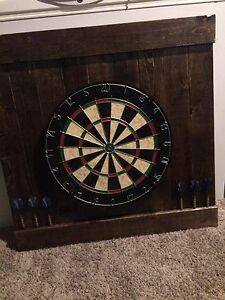 Hand crafted dart board backing with dart board and six darts