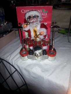 Singing, drumming santa