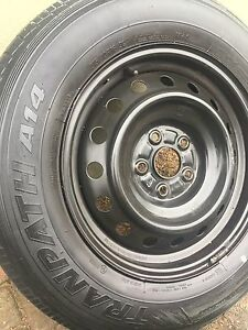 All season and winter tires on rims, 215/70/16