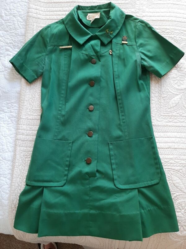 Vintage Girl Scout Uniform with pins badges