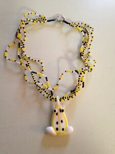 White and yellow frog necklace