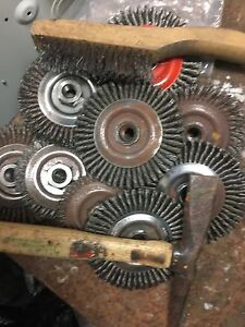 9 wire wheels a chipping hammer and a wire brush