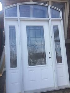 Grand front entrance door with side lights