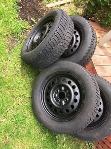 4 winter tires with mag. 4x114.3. (195/65/15)