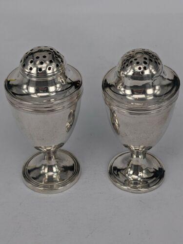 A pair of Georgian silver pepperpots 1797/1798 London assay office