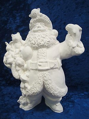 Ready to Paint Ceramic Bisque Santa with a Fish, unpainted; U-paint