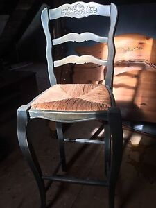 High top chair with wicker seat
