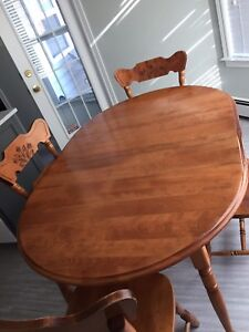 Solid wood dining table with adjustable leaves
