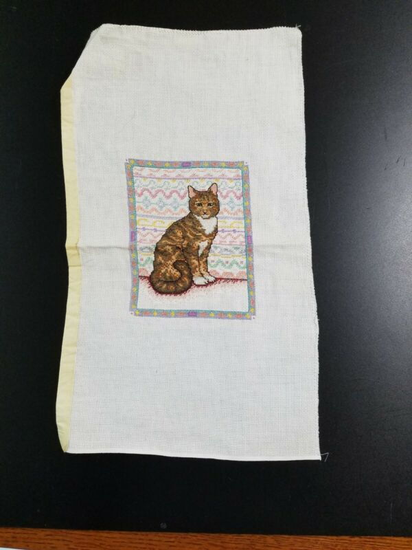 Cat in window, finished counted cross stitch