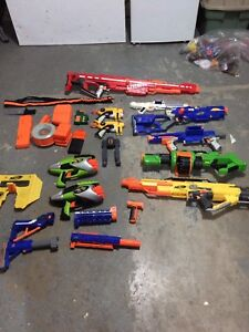 Nerf guns and lots of attachments