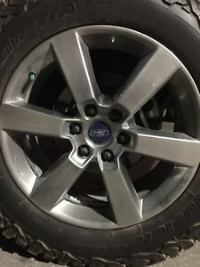 "Ford factory 20"" rims."