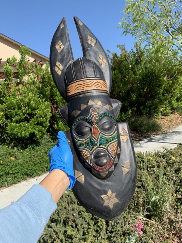 African Black wooden mask made in Ghana hand carved