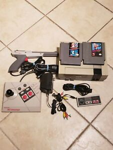 Nintendo NES with Accesories and Game - 160