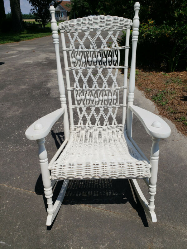 Vintage Wicker Rocking Chair Intricate Detail Never outdoors.