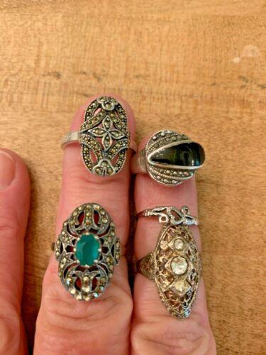 lot of five Sterling silver rings, rhinestone, crystal, green