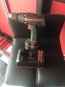 Snap on drill with charger.