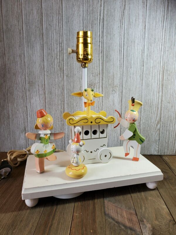 VINTAGE WOODEN LAMP CIRCUS LIGHTS UP & PLAYS MUSIC FROM VINTAGE PLASTICS INC.