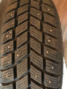 4  STUDDED WINTER TIRES 165/65/14