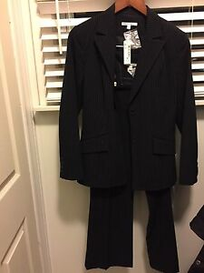 "Black pinstriped suit from ""Smart set ""store"