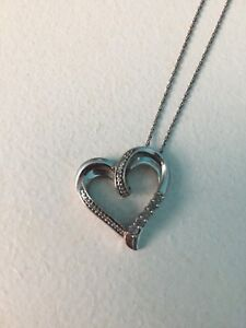 Silver heart pendant with diamonds