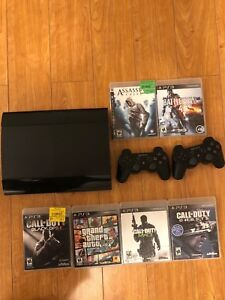 PS3 with games and 2 controllers