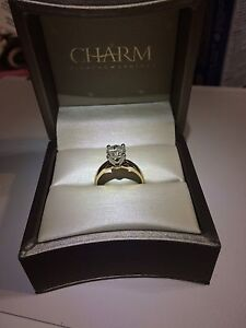 Charm engagement ring