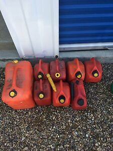 Gas cans seven small and one large