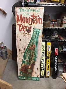 Vertical embossed Mountain Dew sign 306-717-9678