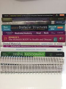 Dental hygiene books with Darby and drug reference