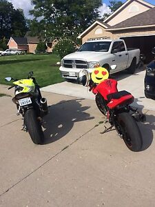 Suzuki Sv650s with two Brothers slip on