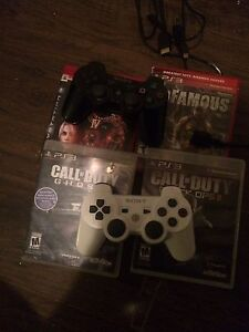 PS3 two controllers and games London Ontario image 4