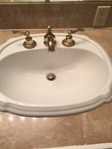 2 Sinks with Faucets