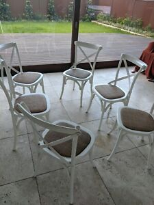 6 x White Cross back dining table chairs $70 each