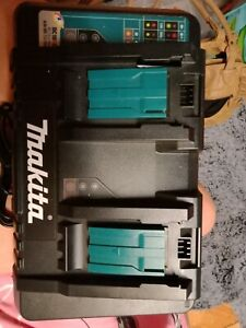 Brand new Makita Dual Battery Charger with 2 Batteries