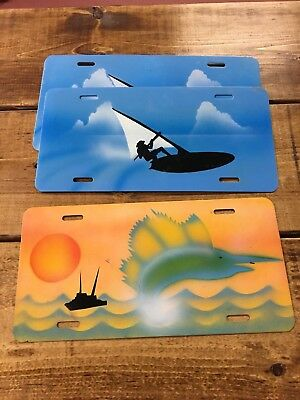 Airbrushed license plate.  Teal blue beach scene. and Orange Beach Scene Blue Airbrushed License Plates
