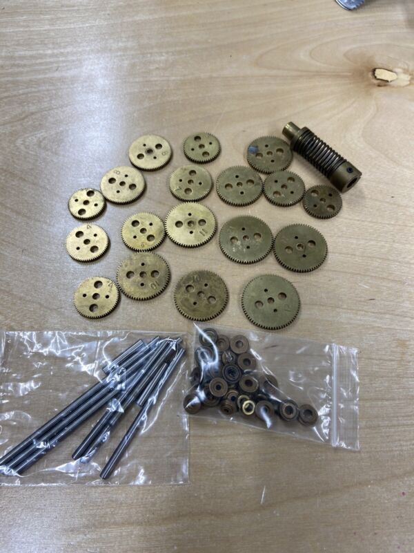 HUGE LOT OF BRASS SPUR PINION GEARS, BRONZE BUSHINGS AND SHAFT ASSORTMENT