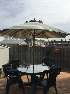 Green patio set with wood umbrella
