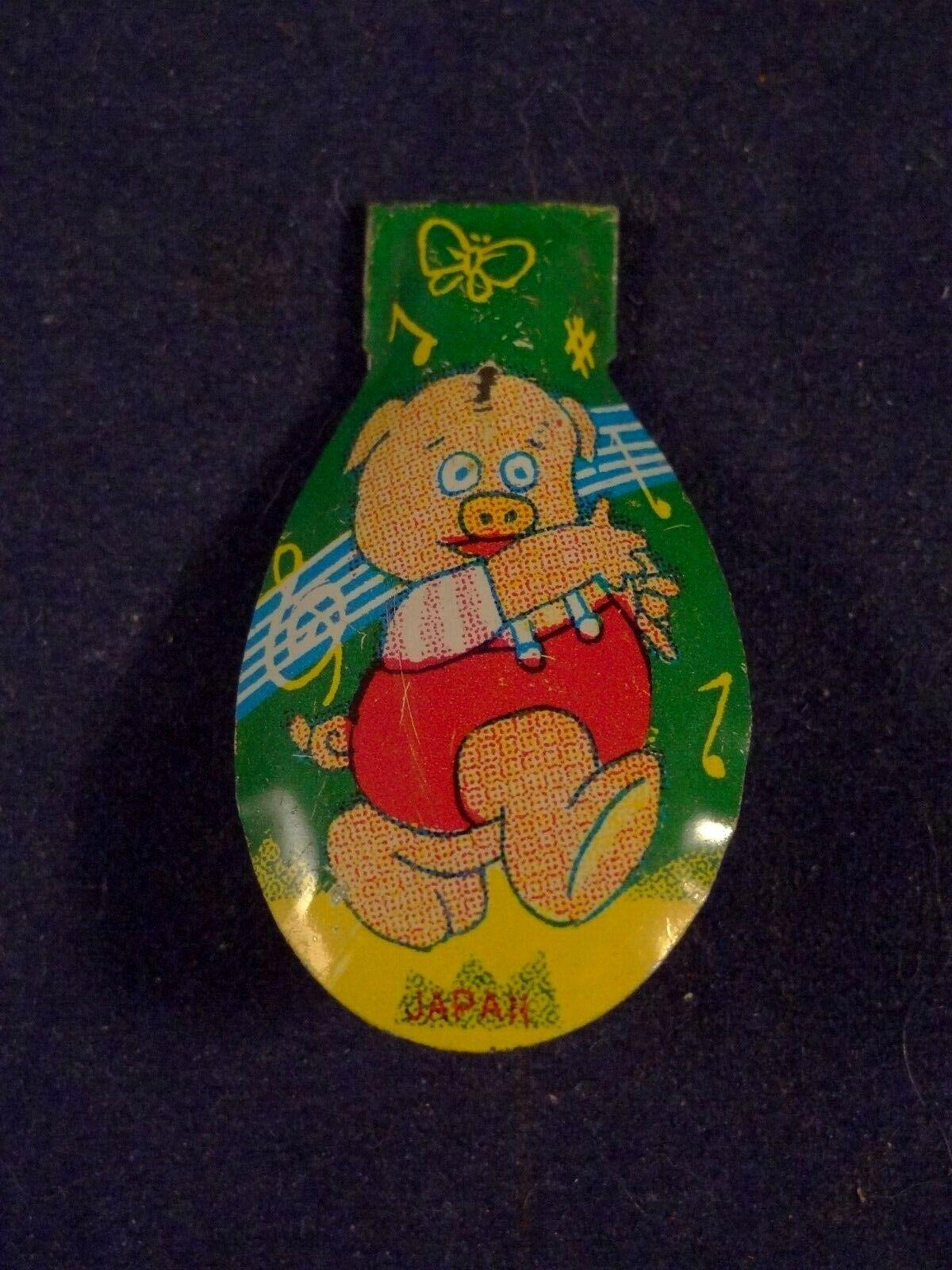 Ancien jouet musical tôle clic-clac cri-cri rare cochon années 60