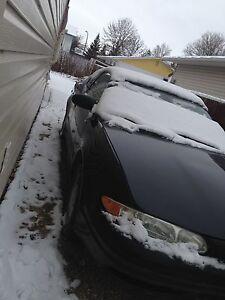 2003 Oldsmobile Alero Gl ,2 door,4cyl.Black,safetied,reamot str