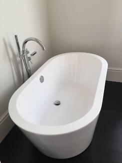 Modern Oval Bath and free standing tap and shower unit