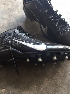 Size 15  cleats.    Never worn