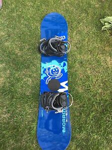 Like new junior snow board complete with bindings