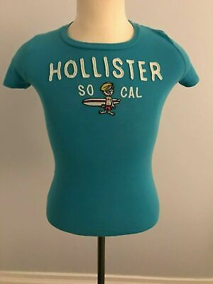 Women's Hollister / Surfer Boy Patch T-Shirt - Blue / Teal - SZ: M - Surfboard