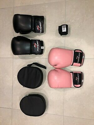 2 pair of Pink And Black Boxing Gloves with Boxing Pads And Hand Wraps.