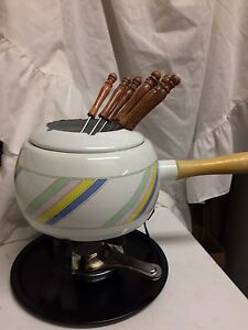 2 fondue pots with ALL pieces and accessories