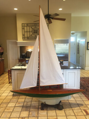 fully restored antique J class pond yacht with wheeled cradle