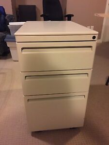 Three drawer filing cabinet on wheels